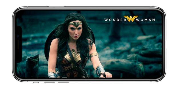 iPhone X with medieval girl on screen