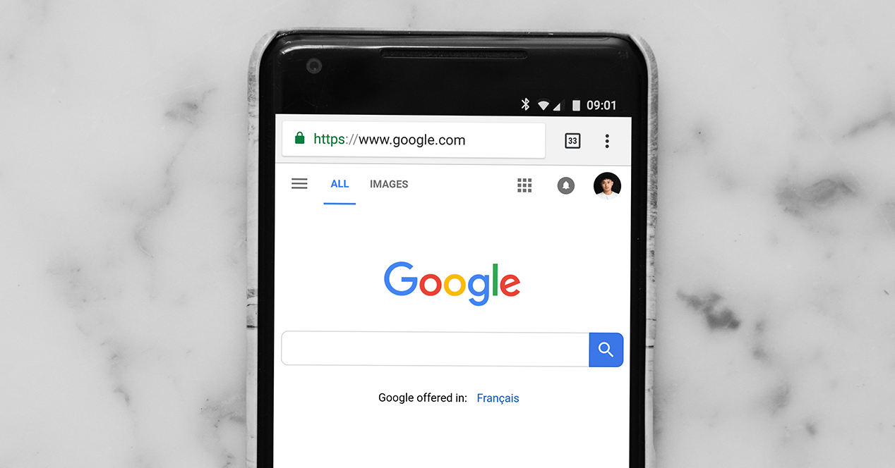 Smartphone with screen on and Google Chrome